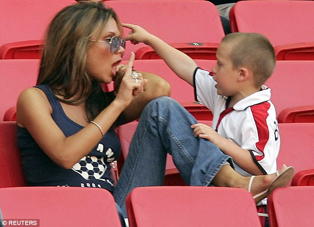 Family bond: Victoria with their son Brooklyn at the Luz Stadium in Lison, in June 2004, before England's match against France