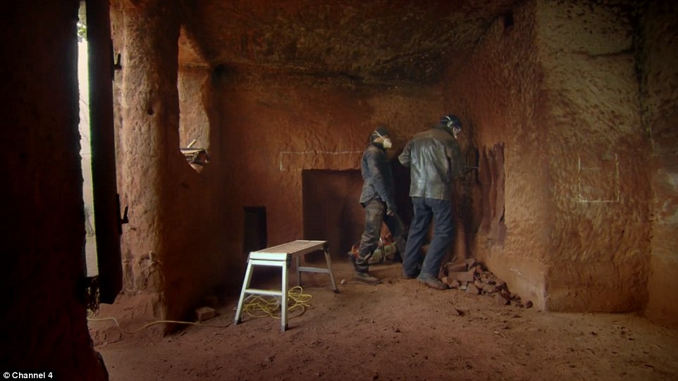 The cave was abandoned in the late 1940s and has been falling into disrepair ever since. Pictured: Presenter Kevin McCloud helps Mr Mastropieto create a built-in wardrobe in what will eventually become one of the cave's bedrooms