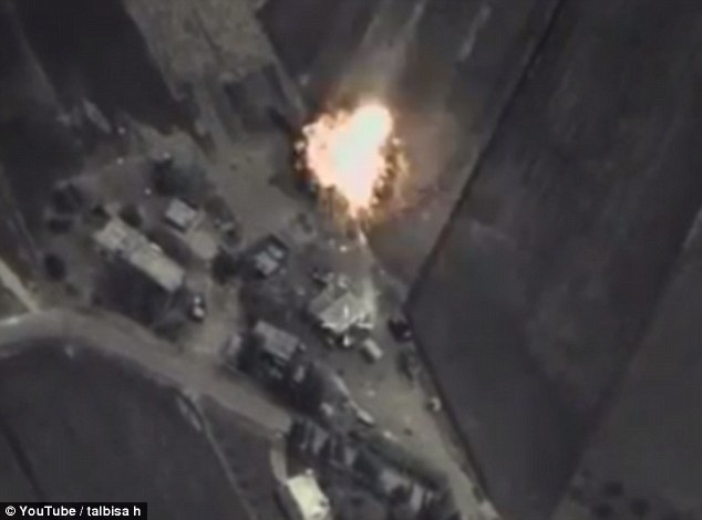 Airstrikes:Russian jets have begun raids in Syria after apparently only giving the U.S. an hour to remove its planes and officials from the area. Pictured: Footage shows rockets hitting the Homs province of Syria today