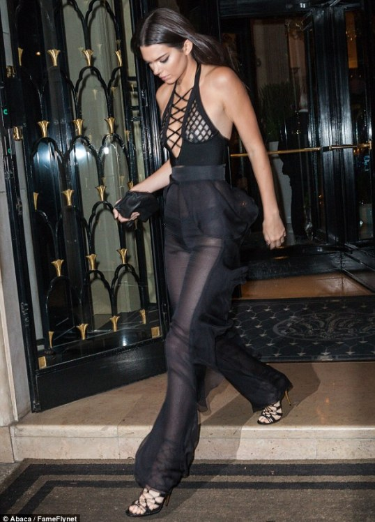 Statuesque: The Americana model - who landed in France earlier this week - completed her daring look with an envy-inducing pair of strappy heels and a small leather purse