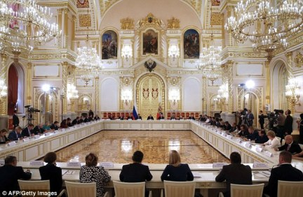 Opulence in war:  Putin addressed members of the Presidential Council for Civil Society and Human Rights (pictured) at the Kremlin in Moscow