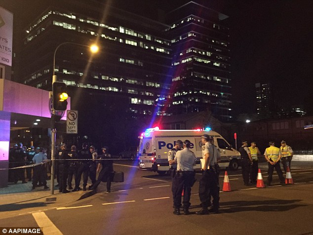 The black-clad assailant fired a number of shots at special constables guarding the NSW Police station in Parramatta on Friday before he was gunned down and killed by one of the officers
