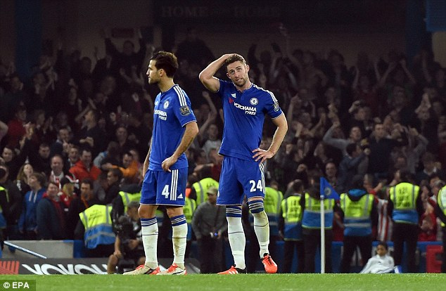 Chelsea duo Cesc Fabregas (left) and Gary Cahill look dejected after a Southampton goal
