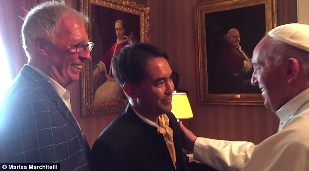 Meeting: The pope's meeting with Washington resident Yayo Grassi (left), his boyfriend (center) and a few others came to light Friday as the Vatican was distancing itself from claims the pope's meeting with the clerk, Kim Davis, was an endorsement of her stance on same-sex marriage