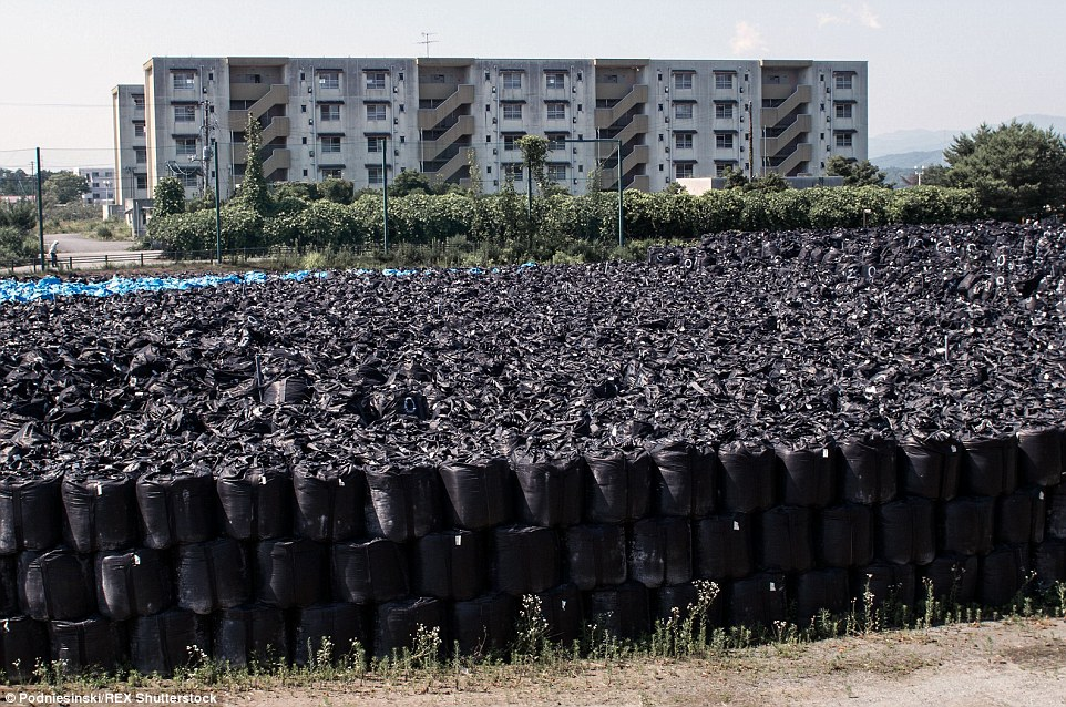 To save space, the radioactive bags of soil are stacked on top of one another. Some 120,000 residents have not yet been allowed back into their homes