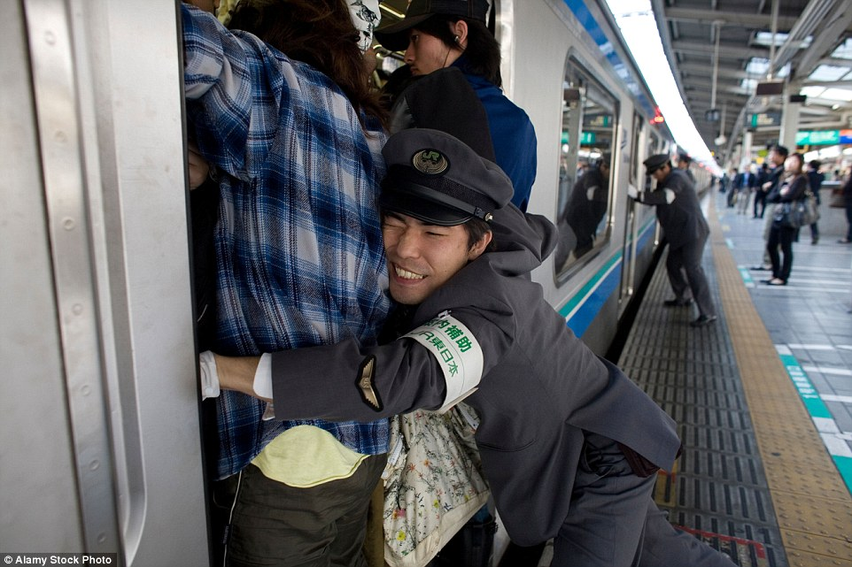 In busy Tokyo stations there are dedicated 'train pushers' on each platform who work to force passengers into crowded carriages during rush hour