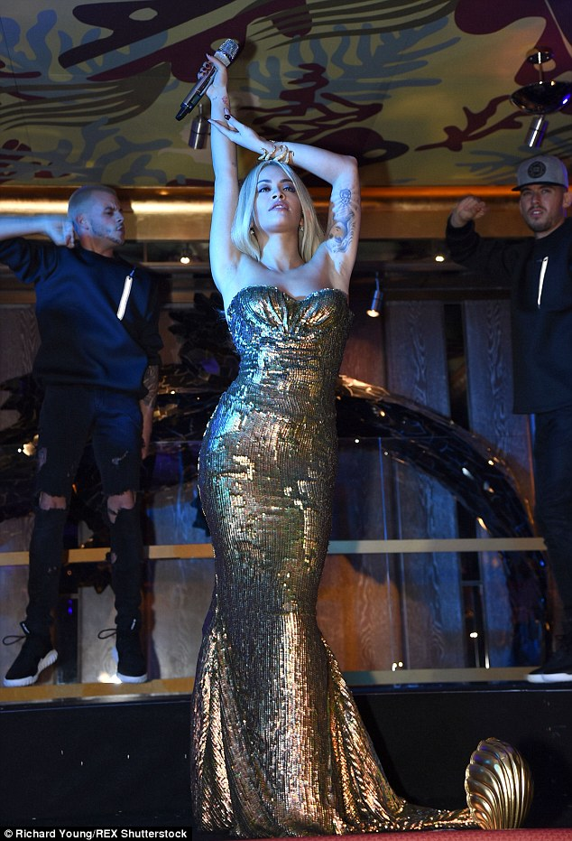 Sensational: The 24-year-old, who is an ambassador of the eatery, was turning heads in the floor-sweeping dress as she oozed Hollywood glamour for her performance at the event