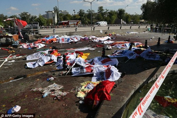 Terrifying: Flags and banners litter the ground shortly after the bomb tore through the packed street