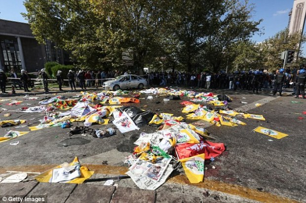 Barbaric: The bloodstained flags of the demonstrators is all that remains from the earlier rally