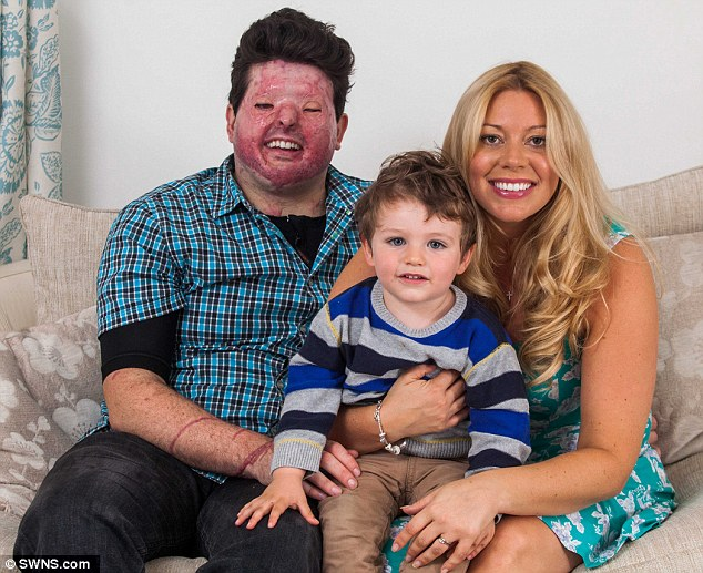 Support: Andreas is rebuilding his life with the help of his wife, Pia, and son, Theo, pictured together