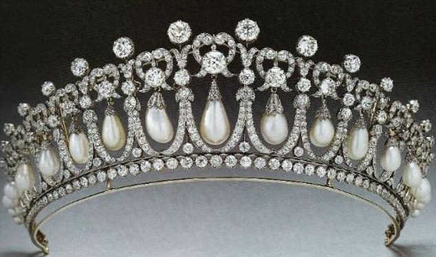 The diamond and pearl-encrusted tiara was made in 1914 and has a strong French influence with a neo-classical design of 19 diamond arches, each cradling an oriental pearl drop
