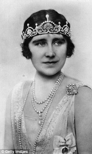 The Queen Mother also wore the Papyrus tiara (right) with a lotus-flower design, which Kate choose for an evening reception in 2013, in the 1920s