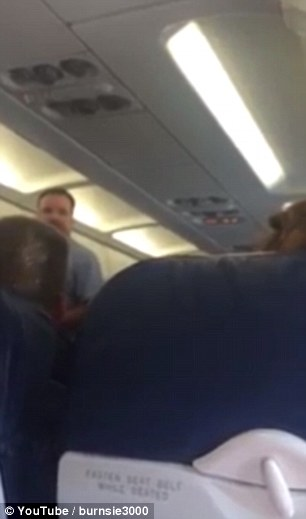 This footage, taken on-board American Airlines Flight 408 to Portland, Oregon, shows a sobbing woman (sat in the right-hand-side seat) pleading with an off-camera female flight attendant after being ordered to leave the plane