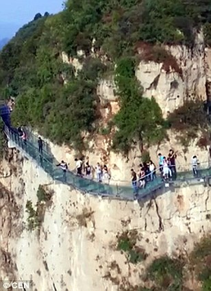 One of travellers biggest fears was                              realised last week when a tourist dropped                              a mug on a glass walkway on the Yuntai                              Mountain, Henan Province causing the floor                              to shatter. The attraction opened in