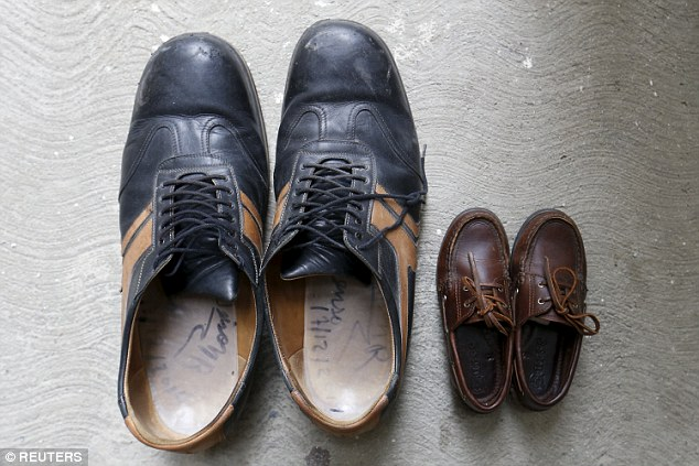 Big foot: The shoes of Jeison Rodriguez, the 20-year-old man from Venezuela who has broken the Guinness World Record for the largest feet, measuring in at 40.1cm