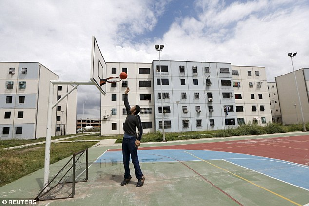 Sportsman: Jeison plays basketball outside his house in Maracay, Venezuela. His mother described how he grew normally until he turned 10, when he experienced a rapid growth spurt