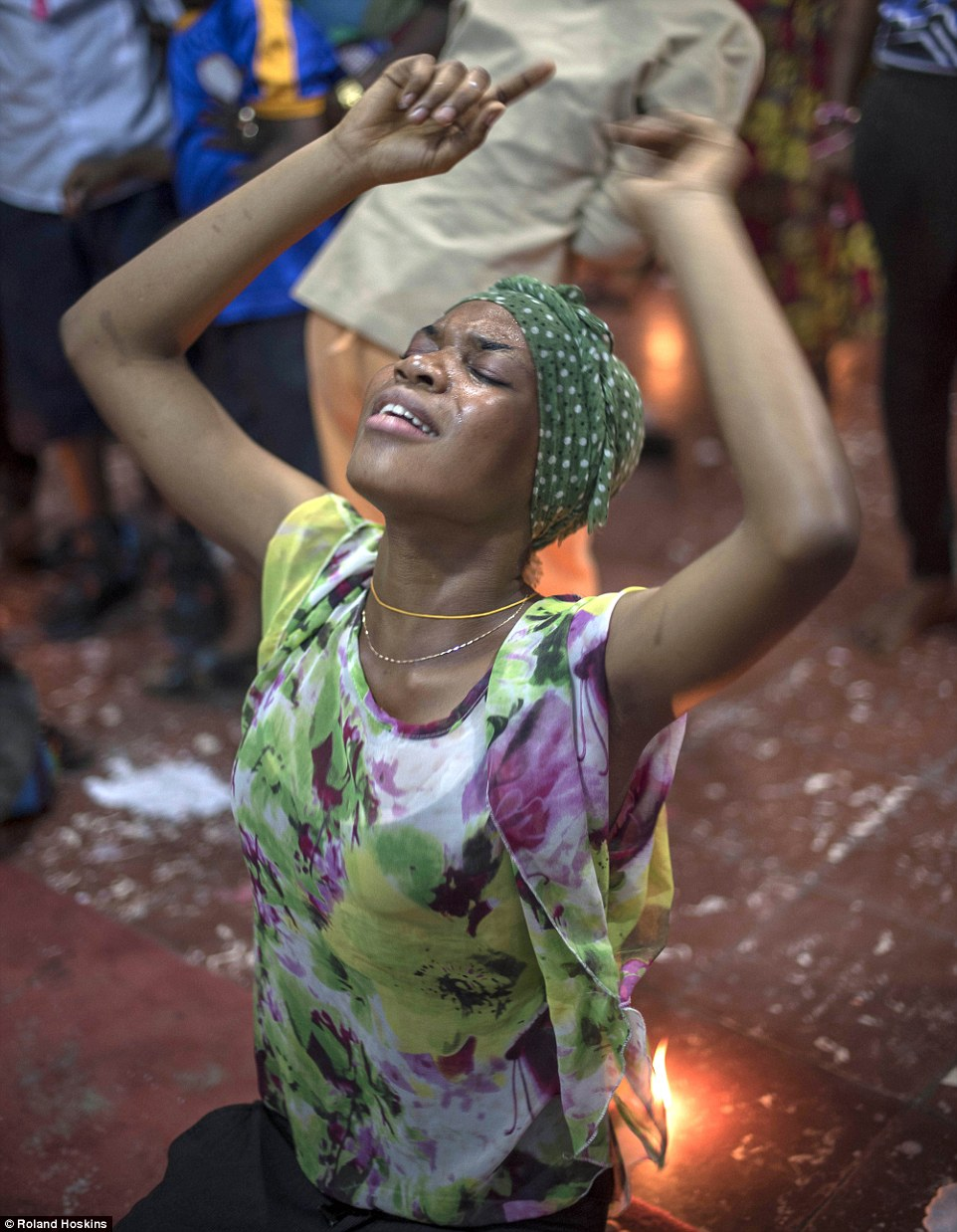 Evil spirits: A woman takes part in an exorcism ceremony in the Democratic Republic of Congo, where many have embraced Catholicism while holding on to traditional beliefs surrounding evil spirits - with some truly horrifying consequences