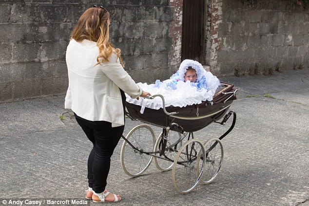 Jas takes Minnie-Beau out for a stroll in her £2,000 pram around Plymouth aged 18-months