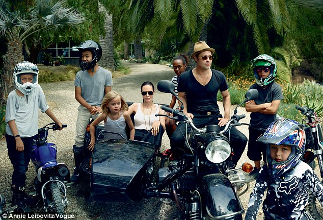 The gang's all here: The actress admitted that she and Brad have some 'issues', but they looked like one blissfully happy couple on bikes with (L-R) Shiloh, Maddox, Vivienne, Zahara, Pax and Knox
