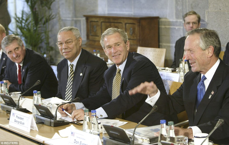 Bombshell dossier: U.S. Secretary of State Colin Powell, left of Bush, wrote to the president to say the UK 'will be with us'