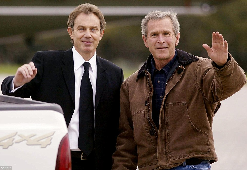 All sewn up: President George Bush and UK prime minister Tony Blair at the infamous 2002 summit at Bush's ranch house in Crawford, Texas, where the two men spoke about invading Iraq