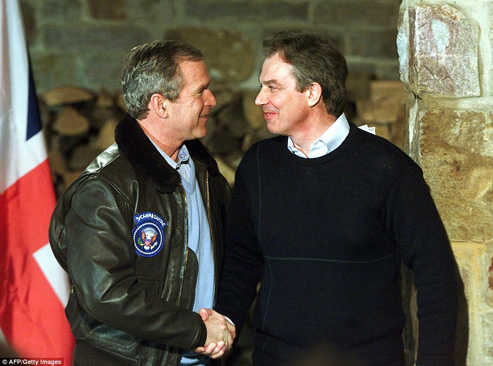 Close: Bush and Blair are pictured above shaking hands at a meeting near Camp Davis in February 2001