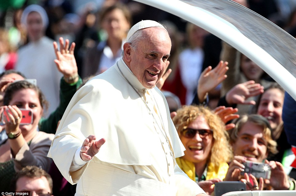 Before the mass, Pope Frances, pictured, was mobbed by large crowds as he was driven through St Peter's Square