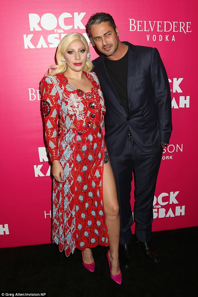 Support: Gaga accompanied her man at the film launch - the handsome gent stars in the movie opposite Kate Hudson and Bill Murray