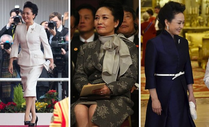 Peng Liyuan wears THREE outfits with husband Chinese President Xi Jinping on first day of