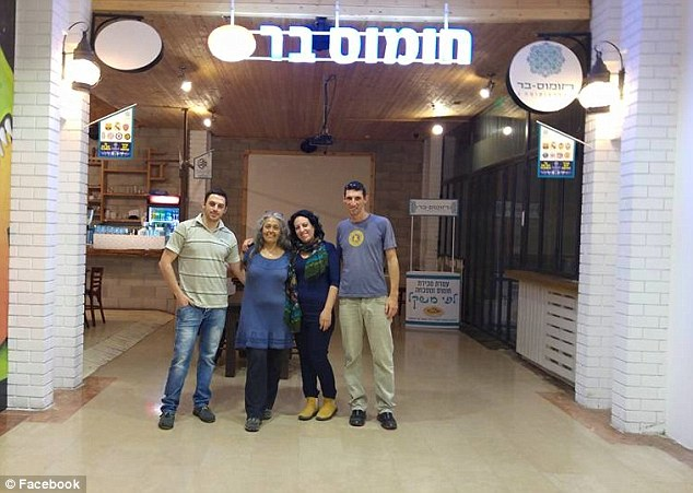 Customers pose outside the Hummus Bar restaurant. The promotion was posted on the company's Facebook page a week ago and has already been 'liked' by nearly 6,500 people and shared 1,600 times