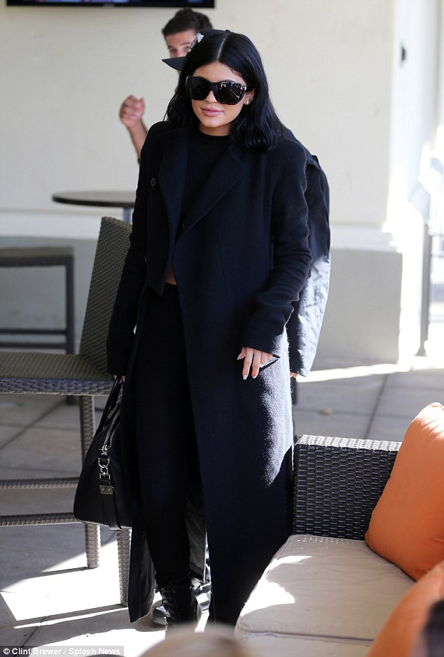 She must be tired: Kylie Jenner, who was in New York City the night before at a Balmian show, wore all black