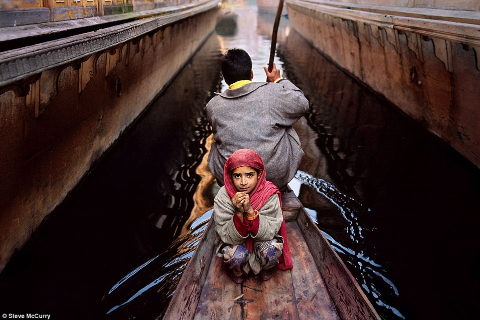Srinagar, Kashmir, 1996. A girl and her father go to the floating vegetable market in their shikara in Srinagar. Much of the city is surrounded by Dal Lake, where thousands of people use these canoe-like boats to go to and from their homes