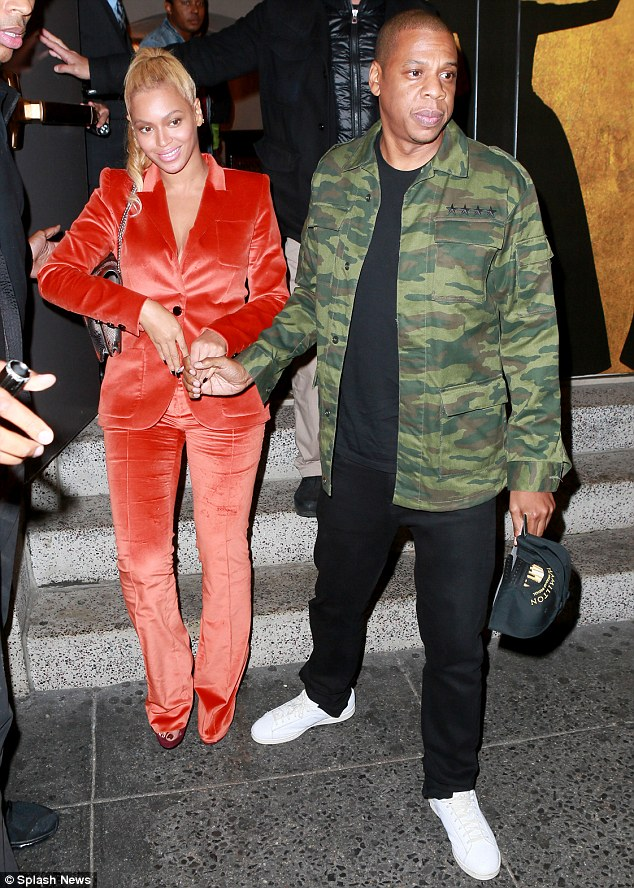 Going retro: Beyonce and Jay Z made for a striking sight as they left a performance of Hamilton in New York City on Wednesday