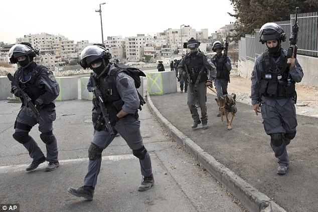 Israeli riot police officers operate in the Arab neighborhood of Issawiyeh in Jerusalem
