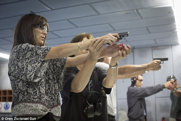 Deathly defiance: Young Israelis practise on a firing range in the Holy city of Jerusalem