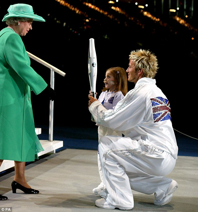 Ceremony: In July 2002, Kirsty, from Wythenshawe, Manchester, was pictured beaming as she helped Beckham hand over the ceremonial baton to the Queen as Her Majesty opened the Commonwealth Games