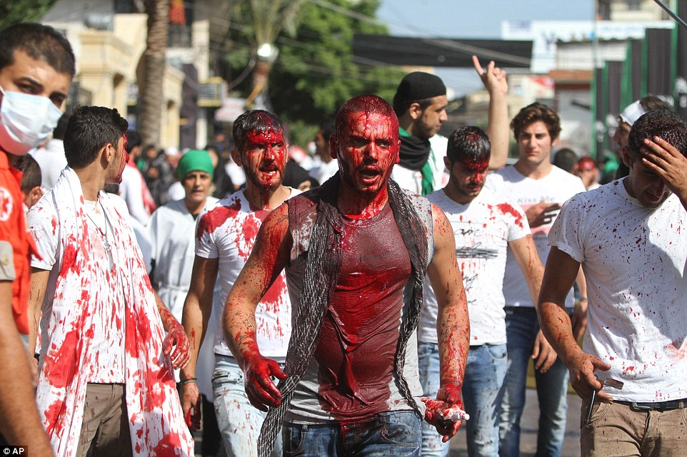 Men in Lebanon are drenched in their own blood after beating themselves with sharp blades to commemorate the Day of Ashura
