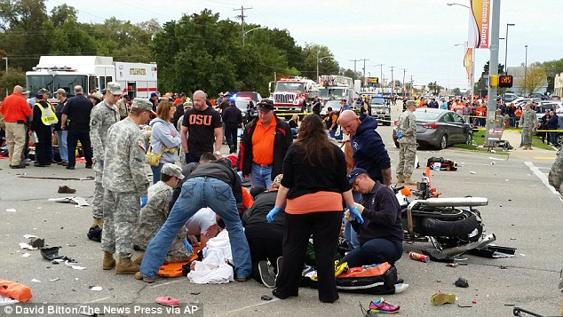 The driver is thought to have run into a police motorcycle at speed before running into parade spectators