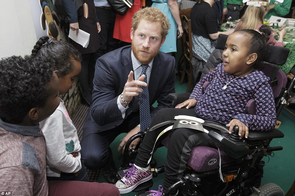 Prince Harry speaks with children and representatives from charities and Aardman Animations during the meeting
