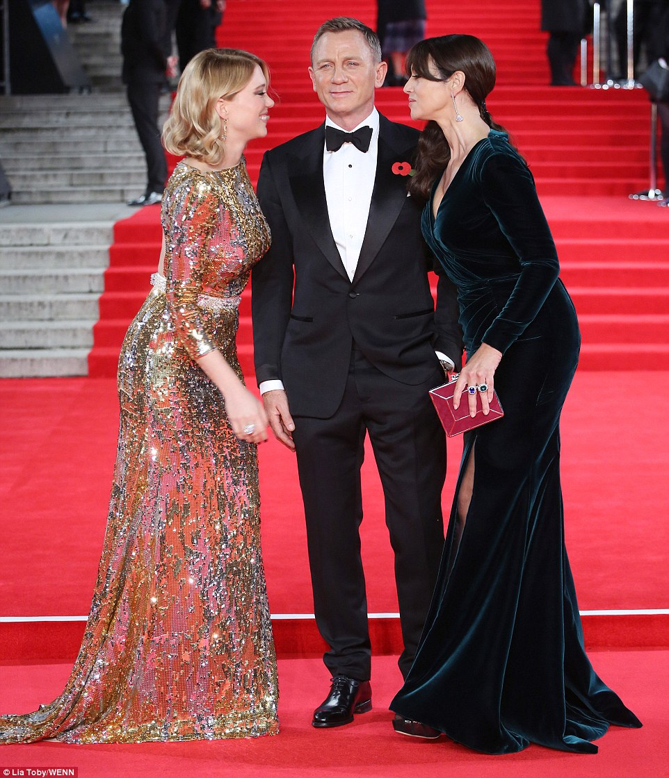 The money shot! Seydoux and Bellucci leaned towards each other to say their hellos as Craig kept his cool