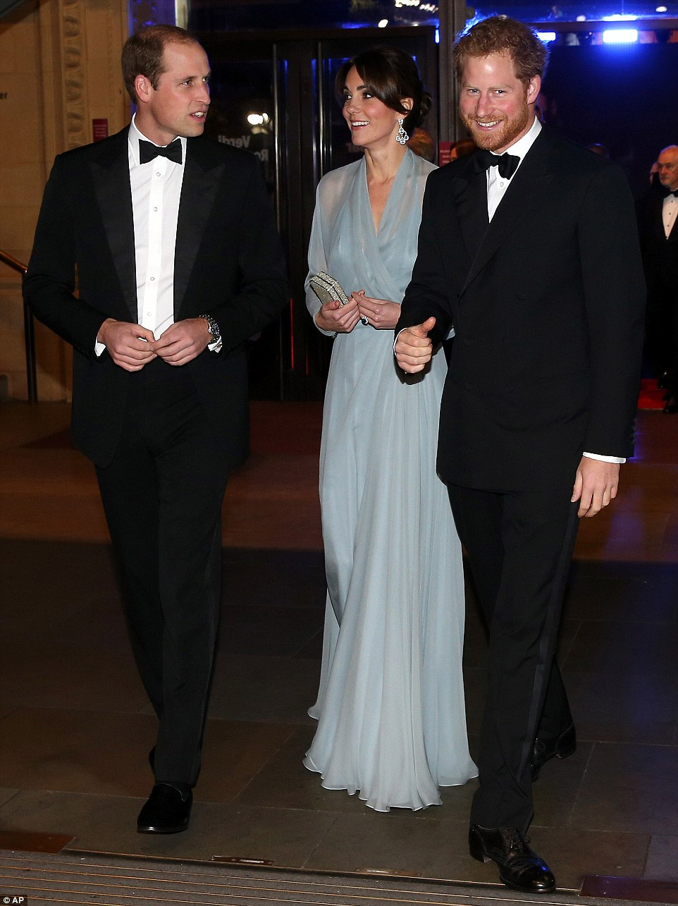 At the Duchess's side - dressed in Bond-style black tie - were her husband, Prince William, and brother-in-law Prince Harry