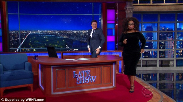 Oprah Winfrey showed off her weight loss in a slimming black velvet frock during the October 15 episode of The Late Show with Stephen Colbert