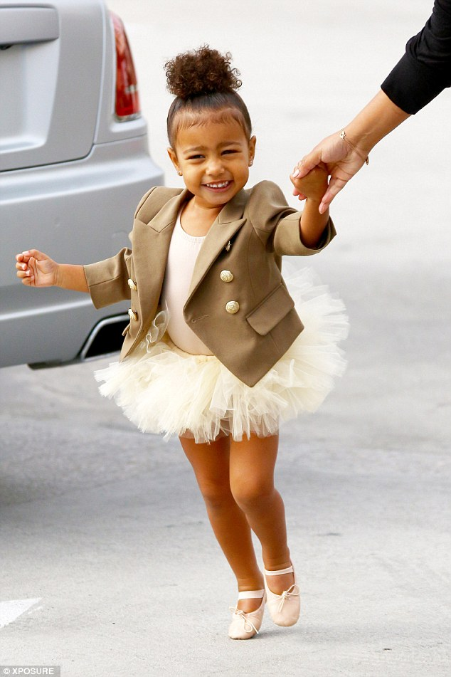 Dance lesson: The tiny ballerina was giggly as she tottered along in her little pumps