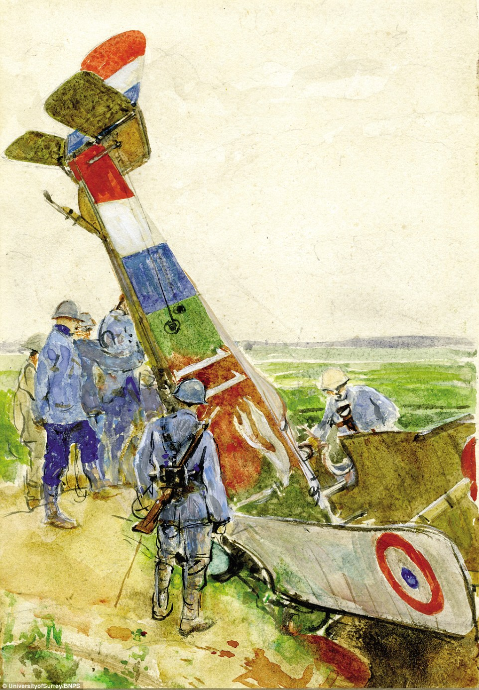 At war: Pictured are soldiers surveying a French biplane which crashed on the Somme battlefield in 1916