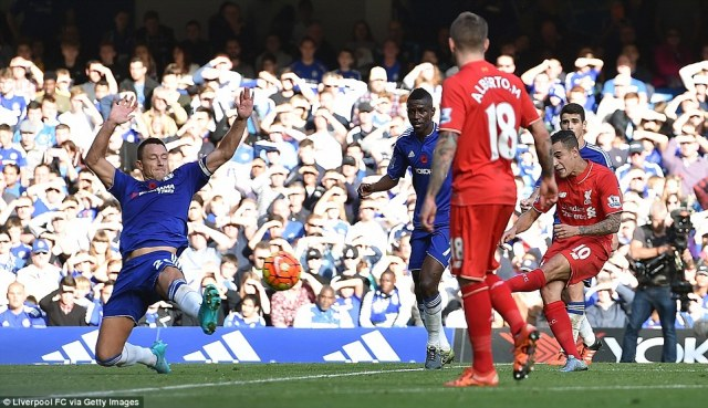 Liverpool forward Philippe Coutinho (right) whips this strike past the challenge of John Terry (left) to equalise for the away side