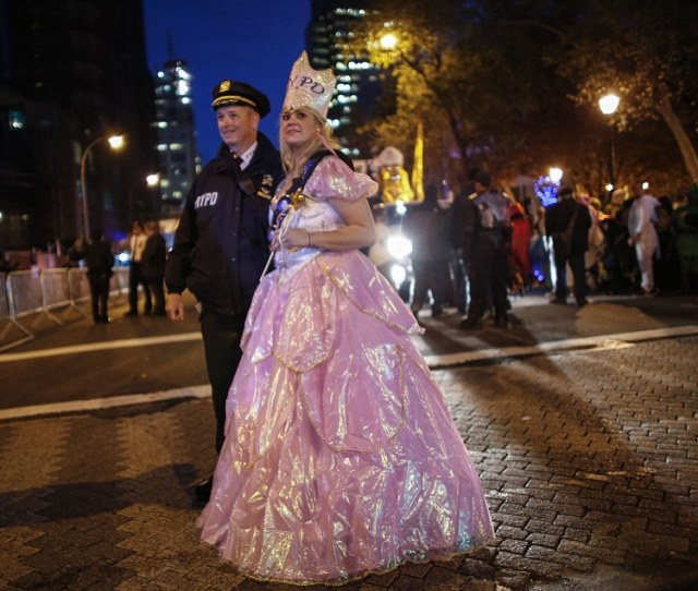 A Woman Dressed Up As A Princess Poses With An Nypd Officer Before The Nd Annual