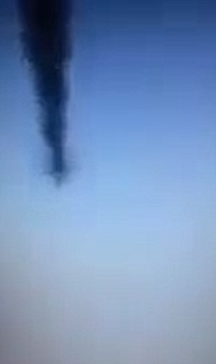 The horrific footage - which was posted online and cannot be verified by MailOnline - shows a large structure resembling a plane falling through the air, before being consumed by a mass of smoke