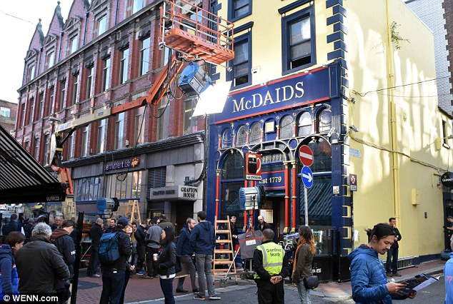 Themise en scène: Members of the crew surrounded McDaids pub as they got on with another day on set