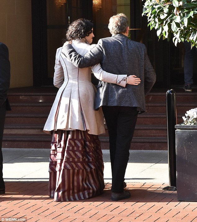 And they're off! Eva and John wrapped their arms around one another as they headed into The Westbury Hotel
