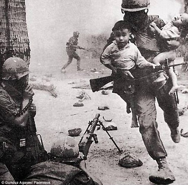 Contrast:Gunduz also injects superhero characters into his images, with one famous photo of a soldier carrying toddlers away from blasts in Vietnam transformed into a scene from an animated action movie